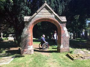 Phil Chambers using his wheelchair in the cemtery