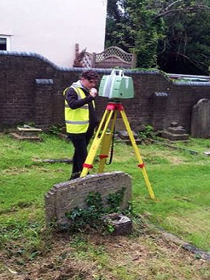 a surveyor laser-scanning the walls