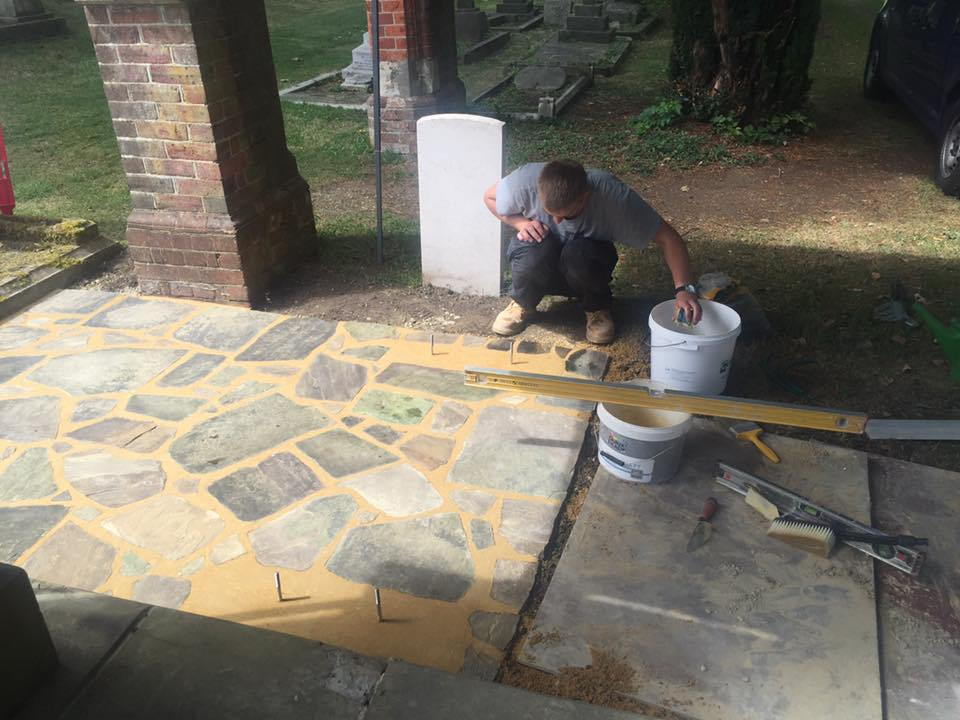 workman laying paving for the seat
