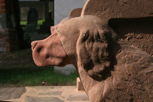 closeup of one of the stone dogs on the restored Seat of Remembrance