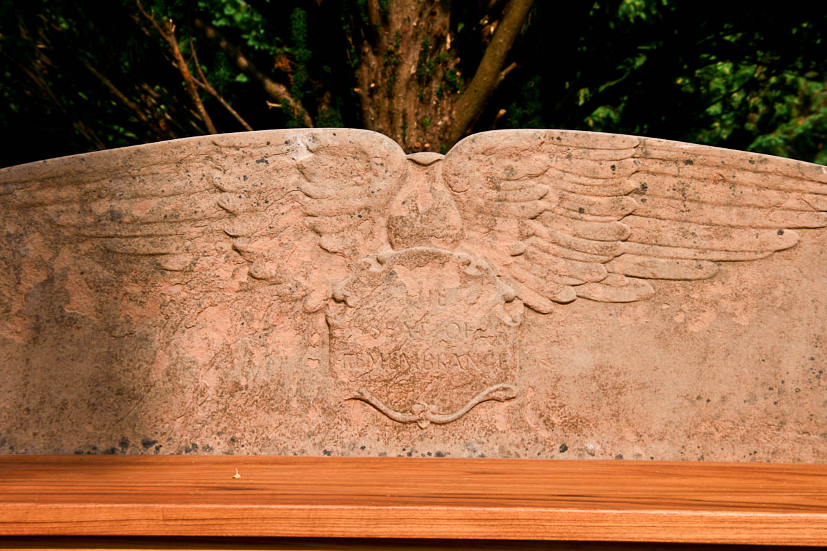 closeup of one of the inscription bearing the words Seat of Remembrance surrounded by heraldic wings