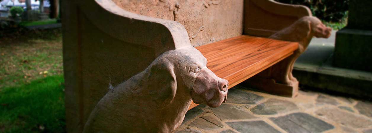 Seat of Remembrance detail - dogs' heads