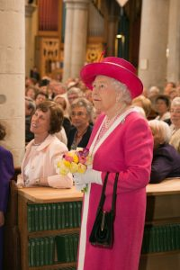 HM the Queen in a matching pink outfit