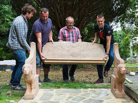 Conservation team lifting the retored Seat of Remembrance into place in 2016