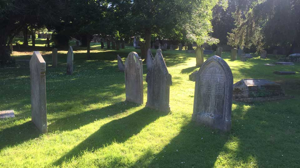 grave stones in sunshine
